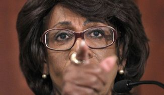 Rep. Maxine Waters, D-Calif. gestures during her news conference on Capitol Hill in Washington, Friday, Aug. 13, 2010, to discuss the House ethics committee investigation. (AP Photo/Pablo Martinez Monsivais)