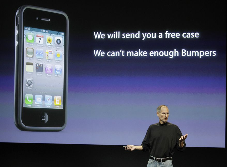 "Apple CEO Steve Jobs talks about free protective cases for Apple iPhone 4 users during a news conference, Friday, July 16, 2010, at the company's headquarters in Cupertino, Calif. Apple Inc. is giving the cases to buyers of the newest iPhone to alleviate the so called ""death-grip"" problem in which holding the phone with a bare hand can muffle the wireless signal. (AP Photo/Paul Sakuma)"