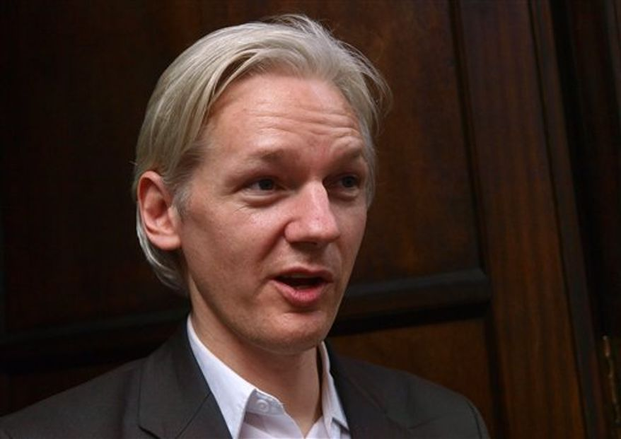 FILE - Founder and editor of the WikiLeaks website, Julian Assange, faces the media during a debate event, held in London Tuesday July 27, 2010.  Assange said Thursday Aug 12 2010 that his organization is preparing to release the rest of the secret Afghan war documents it has on file. The Pentagon warned that would be even more damaging than the organization's initial release of some 76,000 war documents. That extraordinary disclosure, which laid bare classified military documents covering the war in Afghanistan from 2004 to 2010, has angered U.S. officials, energized critics of the NATO-led campaign, and drawn the attention of the Taliban. (AP Photo/Max Nash, file)