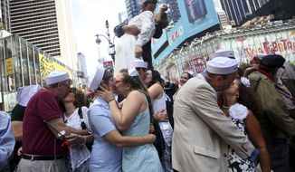 Couples kiss in New York's Times Square, Saturday, Aug. 14, 2010, on the 65th anniversary of VJ Day. (AP Photo/Mary Altaffer)