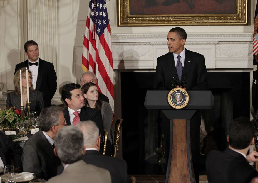 President Barack Obama hosts an iftar dinner, the meal that breaks the dawn-to-dusk fast for Muslims during the holy month of Ramadan, in the State Dining Room at the White House in Washington, Friday, Aug. 13, 2010. (AP Photo/J. Scott Applewhite)