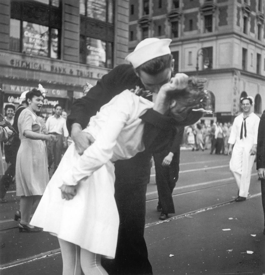 In this Tuesday, Aug. 14, 1945, picture, a sailor and a nurse kiss in Manhattan's Times Square during celebrations for the end of World War II. The celebration followed the official announcement that Japan had accepted the terms of the Potsdam Conference and surrendered. (AP Photo/U.S. Navy, Victor Jorgensen)