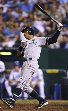 New York Yankees' Alex Rodriguez hits a home run in the seventh inning of a baseball game against the Kansas City Royals, Saturday, Aug. 14, 2010, in Kansas City, Mo. (AP Photo/Ed Zurga)