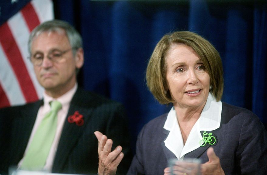 ** FILE ** House speaker Nancy Pelosi and Rep. Earl Blumenauer speak to the press in this Aug. 5, 2010, file photo. (AP Photo/The Oregonian, Motoya Nakamura, File)