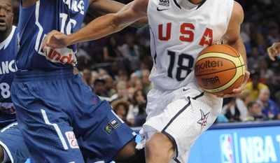ASSOCIATED PRESS United States guard Stephen Curry, right, drives to the basket as France  guard Yannick Bokolo defends during the fourth quarter of an exhibition basketball game Sunday, Aug. 15, 2010, at Madison Square Garden in New York. The U.S. squad won 86-55.