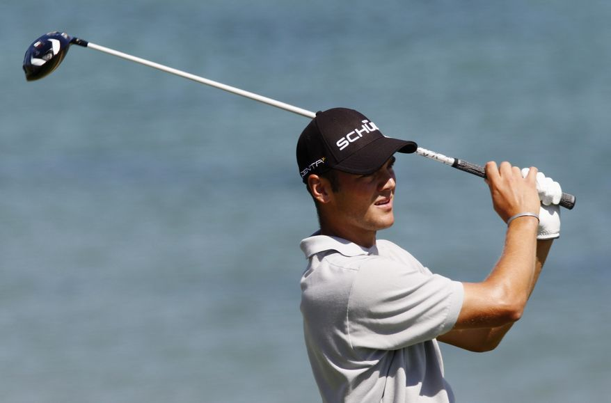 ASSOCIATED PRESS Martin Kaymer of Germany hits a drive on the fourth hole during the final round of the PGA Championship golf tournament Sunday, Aug. 15, 2010, at Whistling Straits in Haven, Wis.