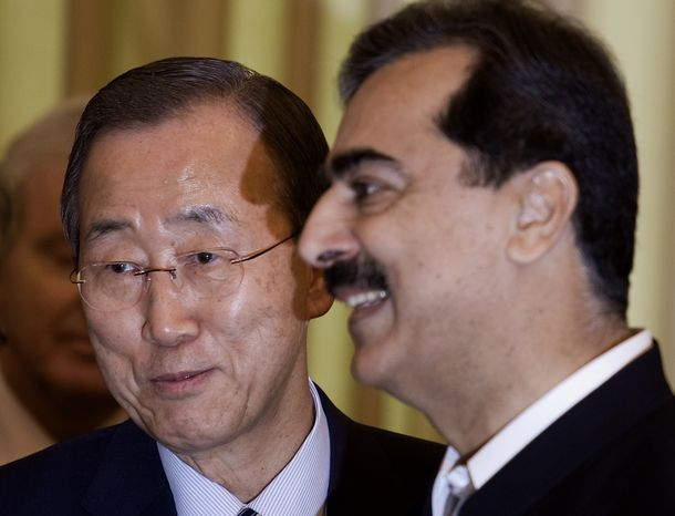U.N. Secretary-General Ban Ki-moon (left) introduces Pakistani Prime Minister Yousuf Raza Gilani to the members of his delegation at the prime minister's house in Islamabad, Pakistan, on Sunday, Aug. 15, 2010. Mr. Ban traveled to flood-ravaged Pakistan to boost relief efforts as the 20 million people made homeless in one of the worst disasters to hit the country grow increasingly desperate. (AP Photo/B.K. Bangash)