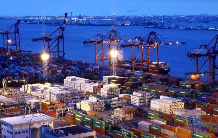 Containers are stacked at a shipping terminal Friday night in Tokyo. Japan's economy in the second quarter grew less than a fifth what was expected pushing it into third place behind the U.S. and China. (Bloomberg)