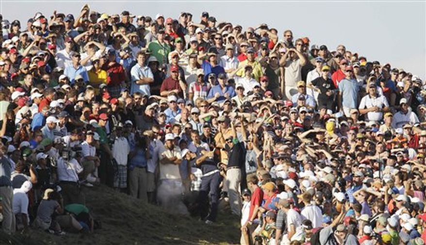 Dustin Johnson hits from the crowd on the 18th hole during the final round of the PGA Championship golf tournament Sunday, Aug. 15, 2010, at Whistling Straits in Haven, Wis. Johnson was given a two-shot penalty for grounding his club before the shot, and missed the playoff. (AP Photo/Eric Gay)