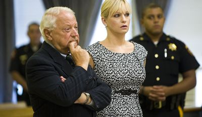 Former U.S. figure skating champion Nicole Bobek stands with her lawyer, Sam DeLuca, during her sentencing hearing at the Hudson County Superior Court in Jersey City, N.J., on Monday, Aug. 16, 2010. She received five years' probation for her role in a crystal methamphetamine ring. (AP Photo/Reena Rose Sibayan, Pool)