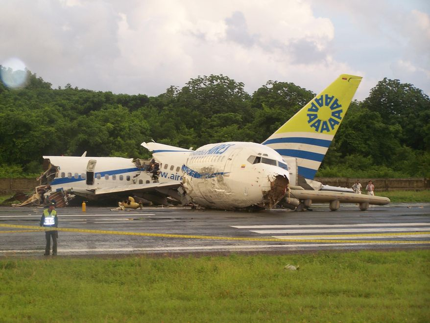 A Boeing 737 operated by the Colombian airline Aires crashed on landing at San Andres Island after departing from Bogota around midnight local time with 131 passengers. According to an Air Force official, one passenger died. (AP Photo/Periodico El Isleno, Richard Garcia)