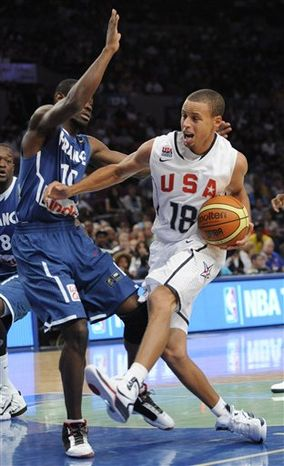 United States guard Stephen Curry, right, drives to the basket as France guard Yannick Bokolo defends during the fourth quarter of an exhibition basketball game Sunday, Aug. 15, 2010, at Madison Square Garden in New York. The U.S. squad won 86-55. (AP Photo/Bill Kostroun)