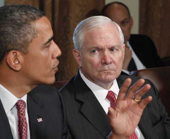 In this June 22. 2010, file photo, Defense Secretary Robert Gates looks on as President Obama speaks in the Cabinet Room of the White House in Washington. Mr. Gates says he plans to leave his job next year. (AP Photo/J. Scott Applewhite, File)
