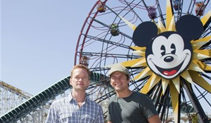 In this photo provided by Disneyland, Neil Patrick Harris and David Burtka pose at Paradise Pier in Disney California Adventure in Anaheim, Calif., on Saturday, Aug. 14, 2010. (AP Photo/Disneyland, Paul Hiffmeyer) ** FILE **