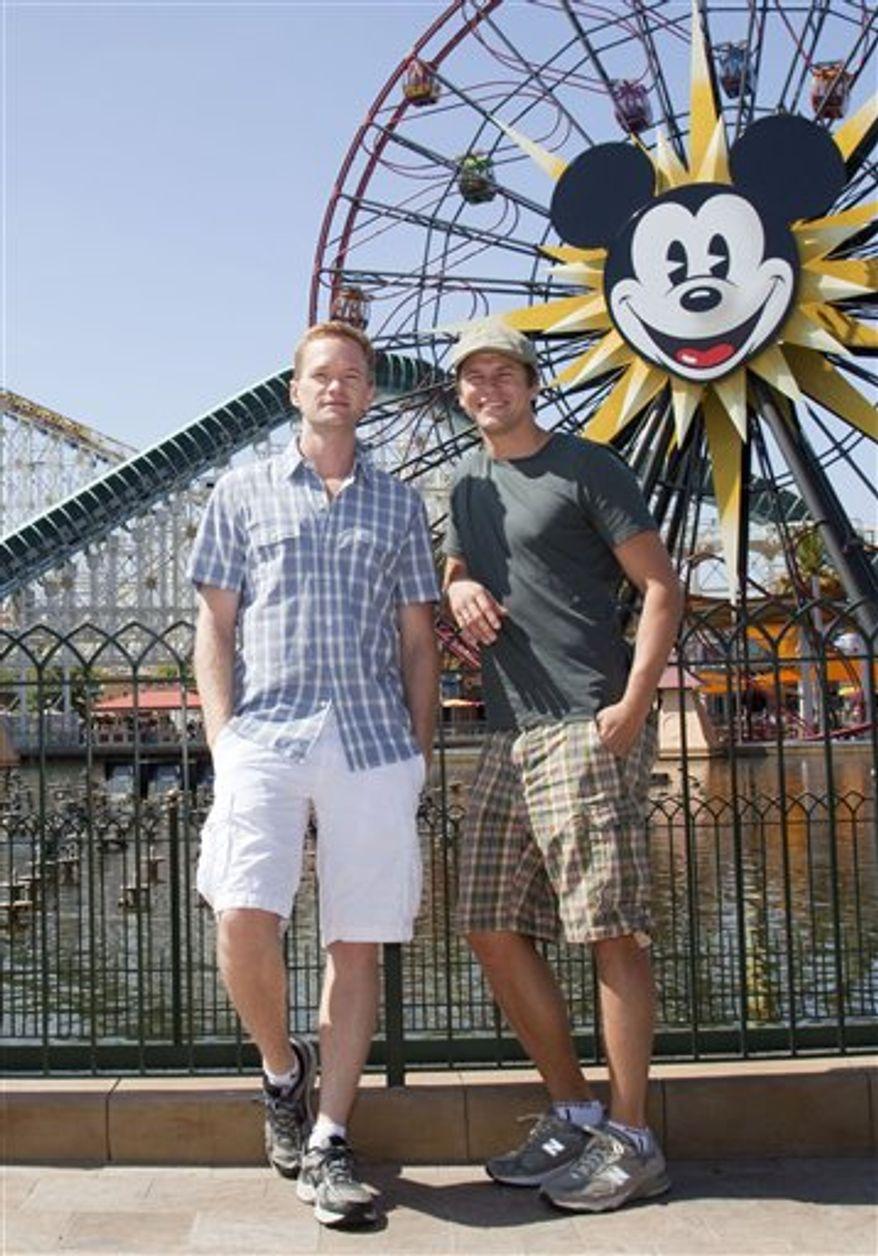In this photo provided by Disneyland, Neil Patrick Harris and David Burtka pose at Paradise Pier in Disney California Adventure in Anaheim, Calif., on Saturday, Aug. 14, 2010. (AP Photo/Disneyland, Paul Hiffmeyer) ** FILE **