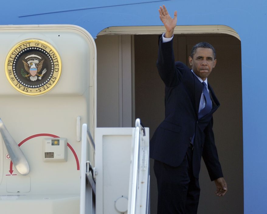 President Obama waves from the top of the steps of Air Force One at Maryland's Andrews Air Force Base on Monday, Aug. 16, 2010, before departing for Wisconsin. (AP Photo/Susan Walsh)