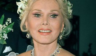 In this Aug. 15, 1986, file photo, actress Zsa Zsa Gabor is shown Los Angeles. Ms. Gabor's publicist says the actress is being returned to a hospital because of complications in her recuperation from a broken hip. (AP Photo/File)