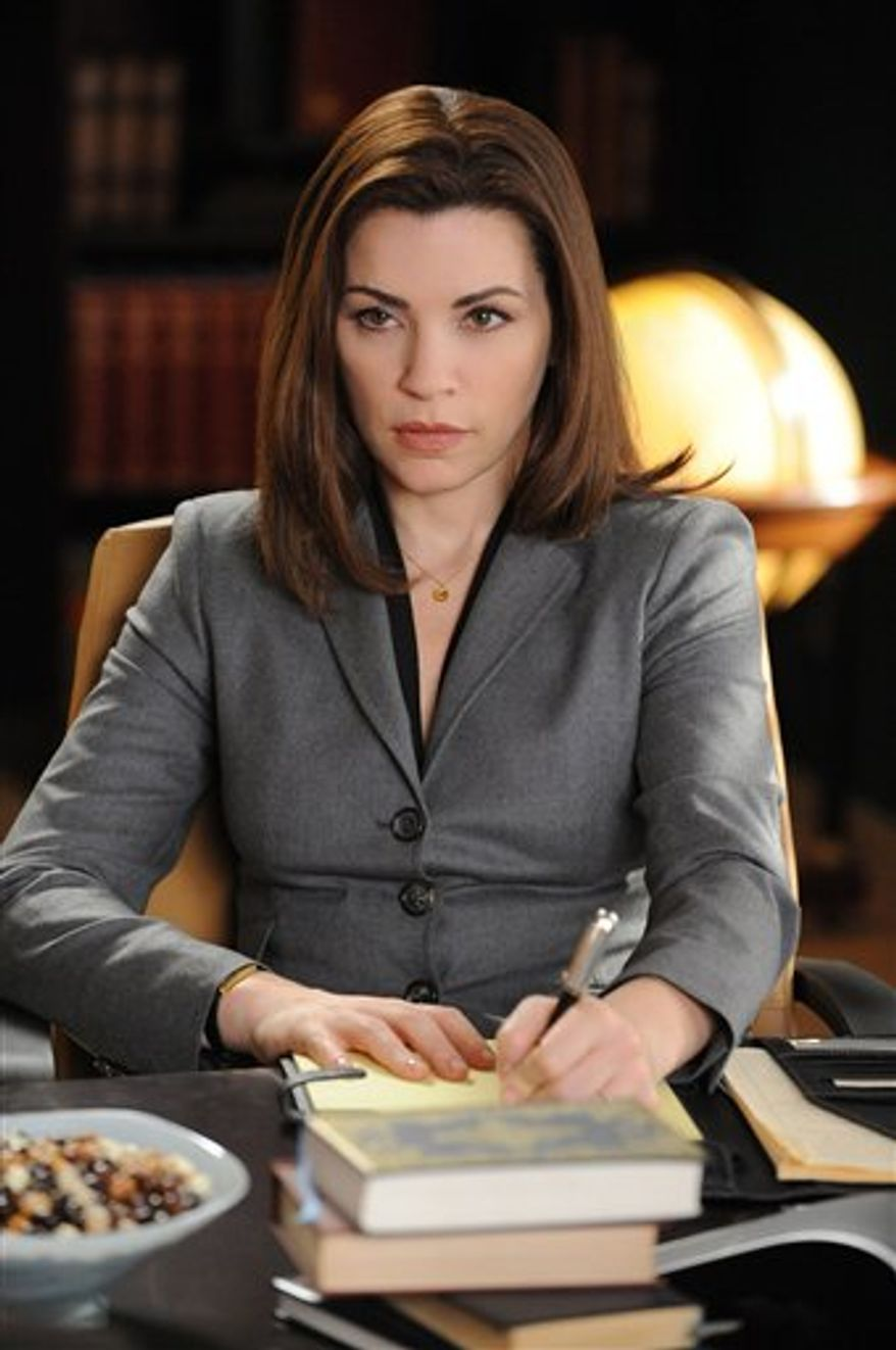 """FILE - In this publicity image released by CBS, Julianna Margulies is shown in a scene from """"The Good Wife.""""  (AP Photo/CBS, David M. Russell)"""