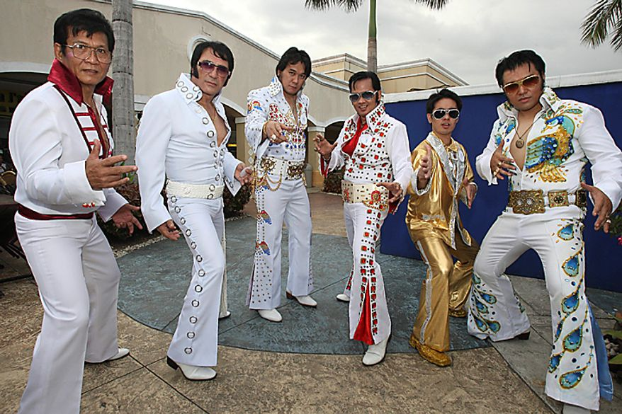 Filipino Elvis Presley impersonators pose prior to a performance Sunday, Aug. 15, 2010, in Manila to pay tribute to the King of Rock 'n Roll on his 33rd death anniversary. About 30 impersonators took part in the singing contest. (AP Photo/Bullit Marquez)