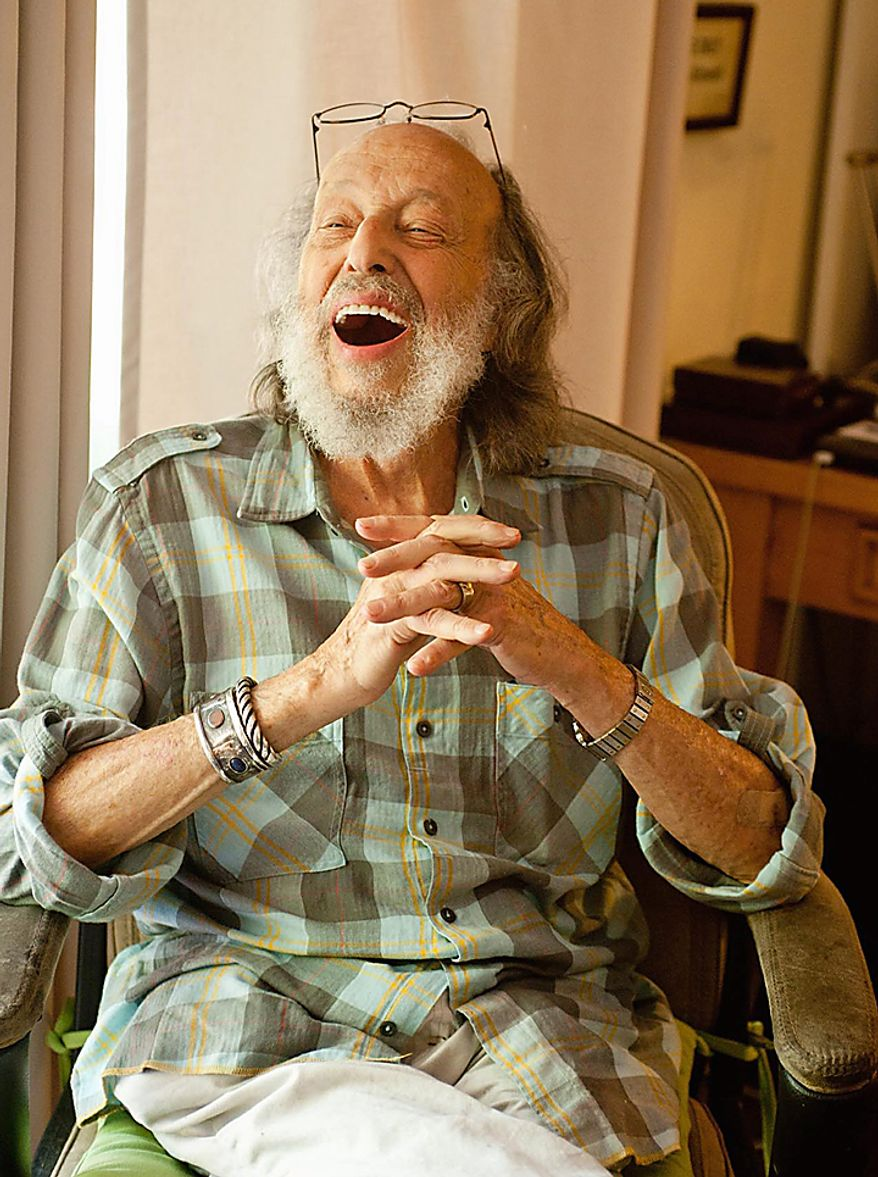 In this photo provided by Jim McHugh, photographer Herman Leonard is seen at his home in Pasadena, Calif., on May 15, 2010. Mr. Leonard, famous for his smoky, backlighted black-and-white photos of such greats as Billie Holiday, Duke Ellington, Charlie Parker, Louis Armstrong, Miles Davis and Frank Sinatra, died Saturday, Aug. 14, 2010, at Cedars-Sinai Medical Center in Los Angeles, family spokeswoman Geraldine Baum said. He was 87. (AP Photo/Jim McHugh)