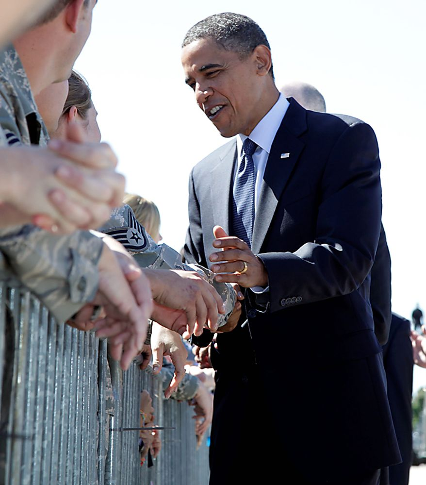 President Obama greets members of the military as he arrives at General Mitchell International Airport in Milwaukee, Monday, Aug. 16, 2010. (AP Photo/Carolyn Kaster)
