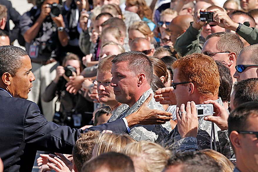 President Obama shakes hands with members of the Wisconsin Air National guard upon his arrival at Mitchell International airport in Milwaukee, Wis., Monday, August, 16, 2010. (AP Photo/Jeffrey Phelps)