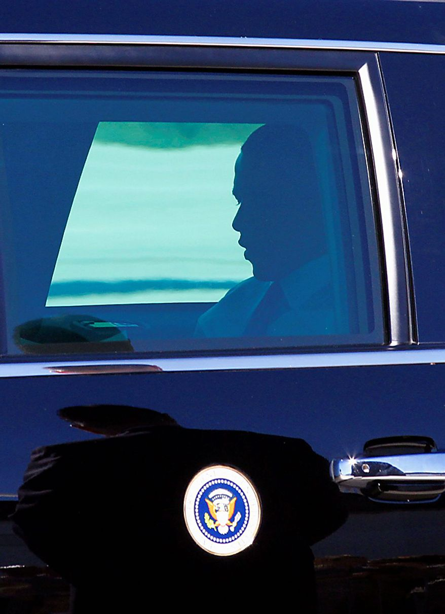President Obama is seen in his limousine upon his arrival at Mitchell International airport in Milwaukee, Wis., Monday, August, 16, 2010.  (AP Photo/Jeffrey Phelps)