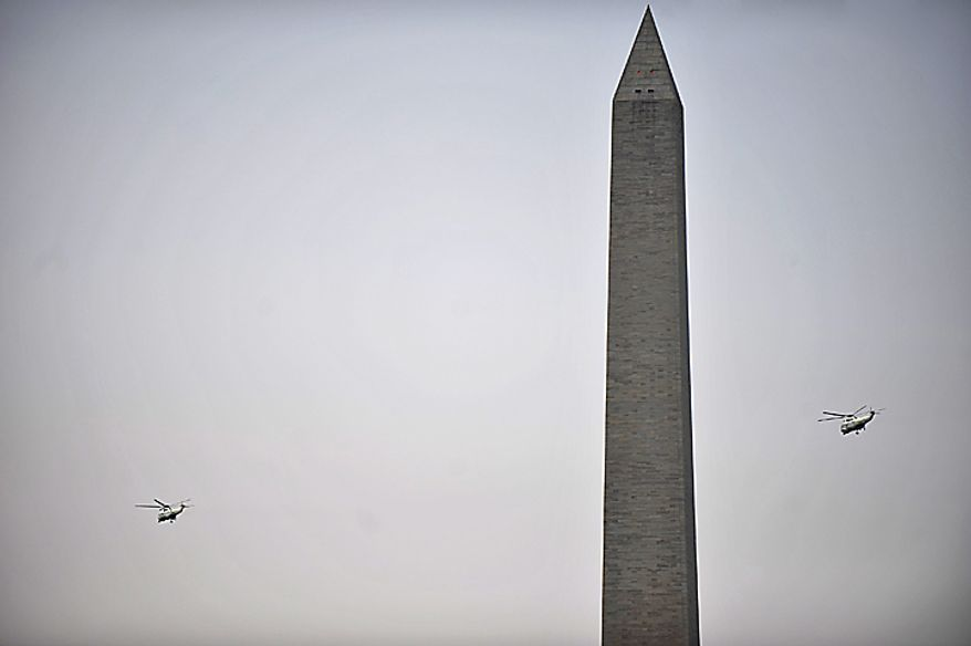 Marine One (L), carrying President Obama, and a support helicopter fly past the Washington Monument as Mr. Obama heads for a trip to Wisconsin and the west coast, in Washington on August 16, 2010. (UPI/Kevin Dietsch)