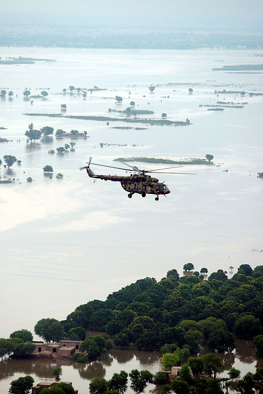 In this photo provided by the United Nations,  U.N.  Secretary General Ban Ki-moon's  helicopter flies over the flood waters in the Province of Punjab, near the city of Multan in Pakistan, Sunday, Aug. 15, 2010. U.N. Secretary General Ban Ki-moon said Sunday he has never seen anything like the flood disaster in Pakistan after surveying the devastation and urged foreign donors to speed up assistance to the 20 million people affected. (AP Photo/United Nations, Evan Echneider)