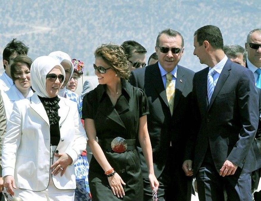 Syrian first lady Asma Assad (left) contacted the Turkish prime minister's wife, Emine Erdogan, to finalize the transfer. Officials say this act of kindness will improve relations between the neighboring countries. (Associated Press)