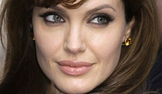 U.S actress Angelina Jolie arrives for the British Gala premiere for the film 'Salt', at a central London cinema, Monday, Aug. 16, 2010. (AP Photo/Joel Ryan)