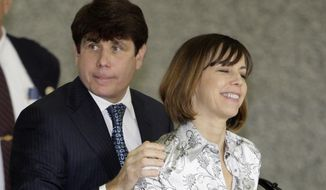 Former Illinois Gov. Rod Blagojevich and his wife Patti arrive Tuesday at the Federal Court building in Chicago. (Associated Press)