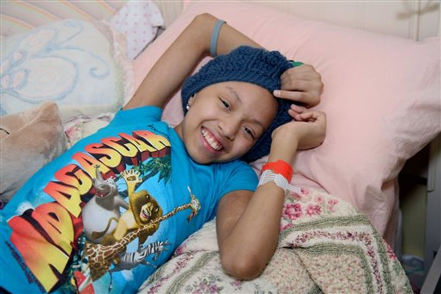 """FILE - In this July 15, 2010 file photo, Shannon Tavarez relaxes in her room in the Queens Borough of  New York. The 11-year-old actress who suffers from leukemia is recovering after receiving an umbilical-cord blood transplant in a New York hospital, Tuesday, Aug. 17, 2010. The treatment was performed in place of a bone marrow transplant because a suitable donor couldn't be found. Shannon had played a young Nala in """"The Lion King"""" on Broadway. (AP Photo/Rick Maiman, File)"""