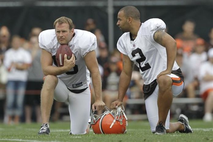 In this Saturday, July 31, 2010 photo Cleveland Browns punters Dave Zastudil, left, and Reggie Hodges (2) watch drills during the opening day of the Browns NFL football training camp in Berea, Ohio. The team announced Tuesday, Aug. 17 2010 they had placed Zastudil on injured reserve. (AP Photo/Amy Sancetta)