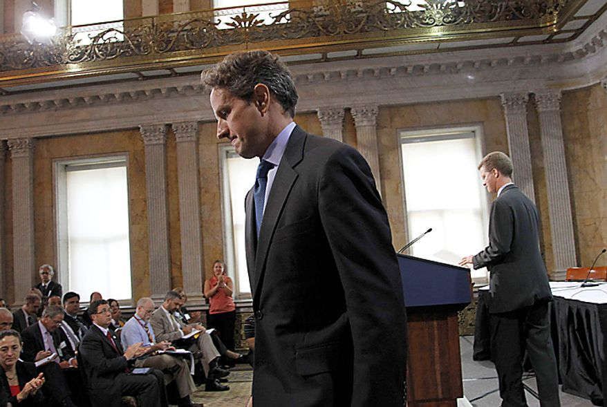 Treasury Secretary Timothy Geithner, left, walks off stage after addressing the Conference on the Future of Housing Finance, Tuesday, Aug. 17, 2010, at the Treasury Department in Washington, Tuesday, Aug. 17, 2010. Taking the podium at right is Housing and Urban Development Secretary Shaun Donovan. (AP Photo/Pablo Martinez Monsivais)