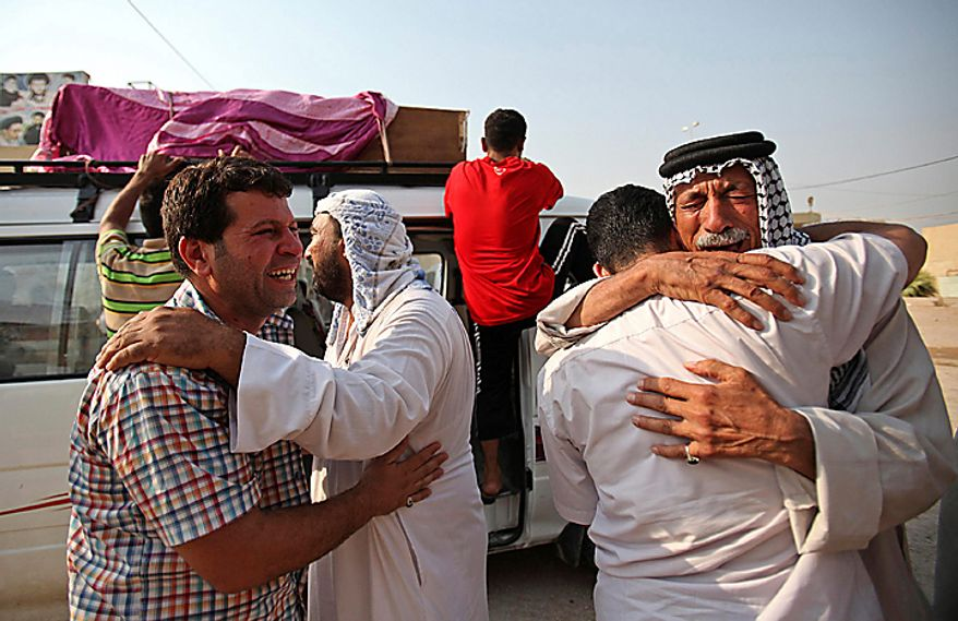 Family members of Saif Ali, 24, grieve during his funeral in Najaf, south of Baghdad, Iraq, Tuesday, Aug. 17, 2010. Ali was killed when a suicide bomber sat for hours Tuesday among hundreds of army recruits before detonating nail-packed explosives strapped to his body, killing and wounding dozens of them and casting new doubt on the ability of Iraqi forces as U.S. troops head home. (AP Photo)