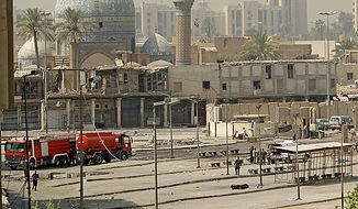 Iraqi security forces inspect the scene of a suicide attack in Baghdad, Iraq, Tuesday, Aug. 17, 2010. A suicide bomber blew himself up among hundreds of army recruits who had gathered near a military headquarters killing and wounding dozens of them, one of the bloodiest bombings in months in the Iraqi capital. (AP Photo/Hadi Mizban)