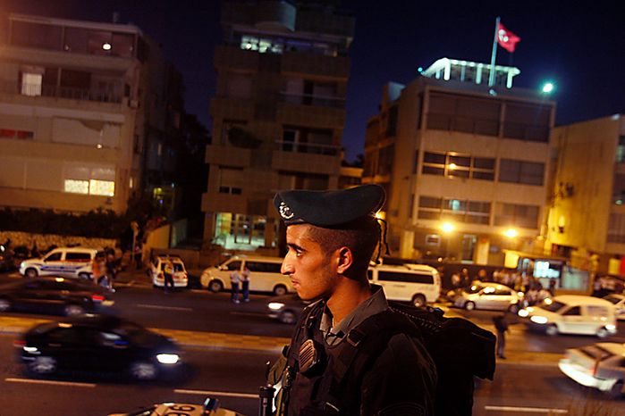 An Israeli border police officer secures the area in front of the Turkish Embassy in Tel Aviv, Israel, Tuesday, Aug. 17, 2010.  Palestinian took hostages in the Turkish Embassy in Tel Aviv Tuesday after shots were fired outside, Israeli police and a Foreign Ministry official said, in an incident that appeared to have only an indirect link to recent tensions between the two countries. (AP Photo/Dan Balilty)