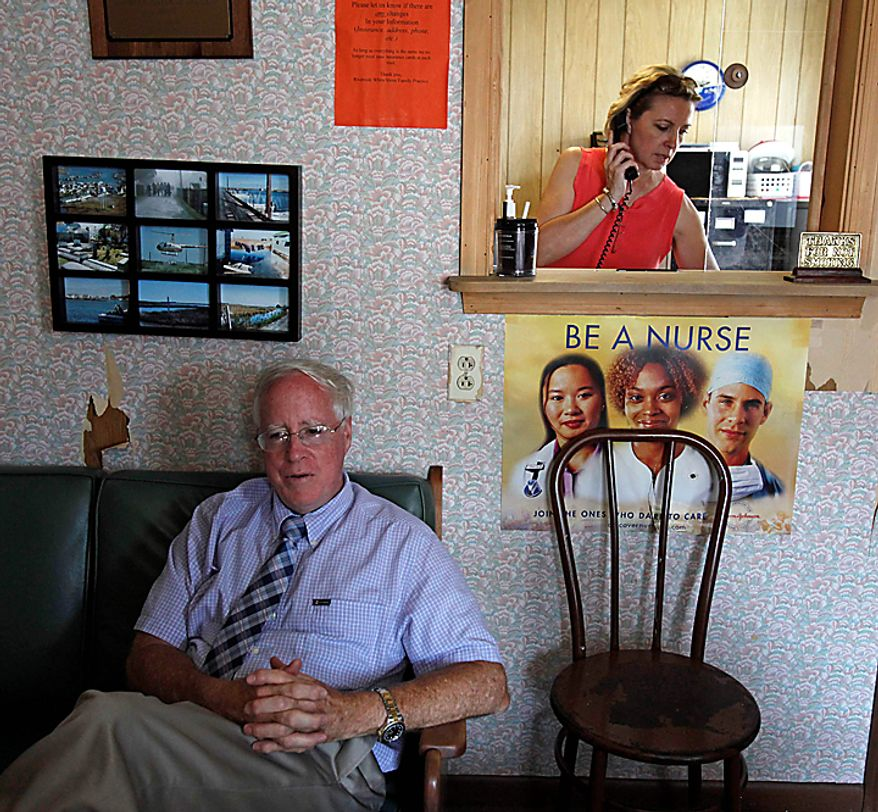 Physician's Assistant Inez Pruitt, right, takes a call as Dr. David Nichols relaxes inside the old health clinic on Tangier Island, Va., Monday, Aug. 9, 2010.  The brand new Tangier Island Health Clinic is scheduled to open Aug. 29. Dr.  Nichols, who has been flying to Tangier to care for the residents for 30 years, has been diagnosed with terminal cancer. (AP Photo/Richmond Times-Dispatch, Bob Brown)