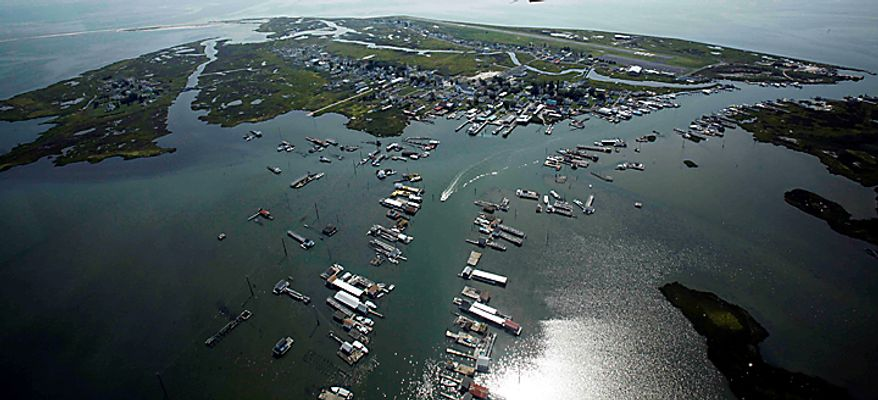 This aerial view shows Tangier Island, Va. surrounded by the Chesapeake Bay, Monday, Aug. 9, 2010. For more than 30 years, Dr. David Nichols has piloted a plane or a helicopter across the Chesapeake Bay on his day off each week to provide medical care to this community of 500 that has no resident physician.  (AP Photo/Richmond Times-Dispatch, Bob Brown)