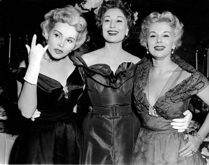 ASSOCIATED PRESS Zsa Zsa Gabor (left) and her sisters Magda (center) and Eva, celebrate a 1955 Las Vegas nightclub engagement with a cocktail party at Ciros, then a Vegas hot spot. Zsa Zsa, 93 and the last surviving sister, is critically ill.
