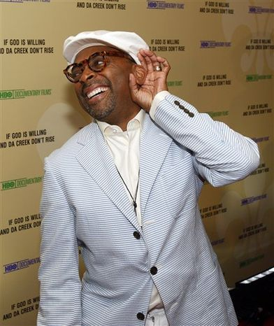 """** FILE ** Director Spike Lee laughs while standing on the red carpet at the premiere of his documentary """"If God Is Willing And Da Creek Don't Rise"""" in New Orleans, Tuesday, Aug. 17, 2010. The film is a follow-up to Lee's """"When The Levees Broke,"""" which depicted New Orleans and the Gulf Coast in the year after Hurricane Katrina.  (AP Photo/Patrick Semansky)"""