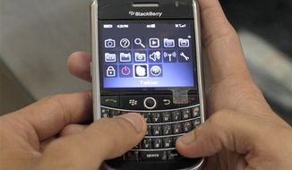 ** FILE ** In this Aug. 5, 2010, file photo, a man uses his BlackBerry in Ahmadabad, India. (AP Photo/The Canadian Press, Ajit Solanki, File)