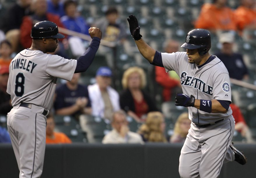 ASSOCIATED PRESS Seattle Mariners third base coach Lee Tinsley (8) congratulates Matt Tuiasosopo, right, after Tuiasosopo hit a three-RBI homerun against the Baltimore Orioles during the second inning of a baseball game, Wednesday, Aug. 18, 2010, in Baltimore.