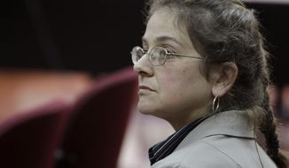 U.S. activist Lori Berenson attends her hearing at court in Lima, Peru, Monday Aug. 16, 2010. On Wednesday, Aug. 18, 2010, a court revoked her parole and ordered her to serve the rest of her sentence. (AP Photo/Martin Mejia)