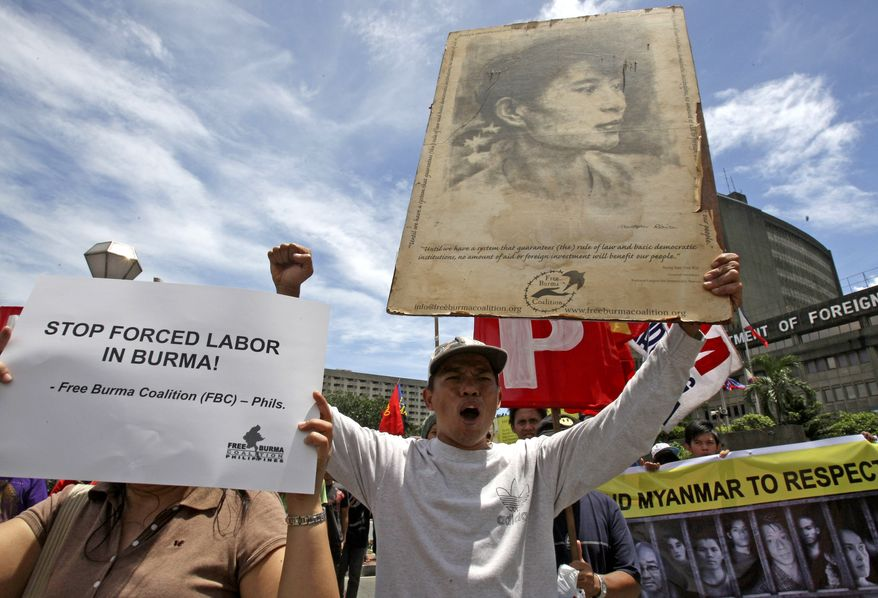 "Protesters display placards and shout slogans during a rally outside the Department of Foreign Affairs in Manila, Philippines, Friday, Aug. 6, 2010, to call on the Philippine Government to ""publicly support"" a United Nations commission of inquiry into purported crimes against humanity in Burma. On Wednesday, Aug. 18, 2010, the United States said it will support the commission. (AP Photo/Bullit Marquez)"