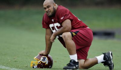 ASSOCIATED PRESS Washington Redskins defensive lineman Maake Kemoeatu takes a knee after NFL football training camp at Redskins Park in Ashburn, Va. Wednesday, Aug. 18, 2010.