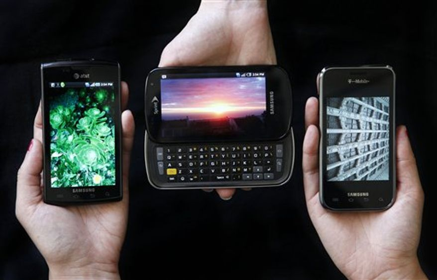 This photo taken Aug. 13, 2010, shows the Samsung Captivate, left, Samsung Epic 4G, center, and the Samsung Vibrant phones in San Francisco. (AP Photo/Jeff Chiu)