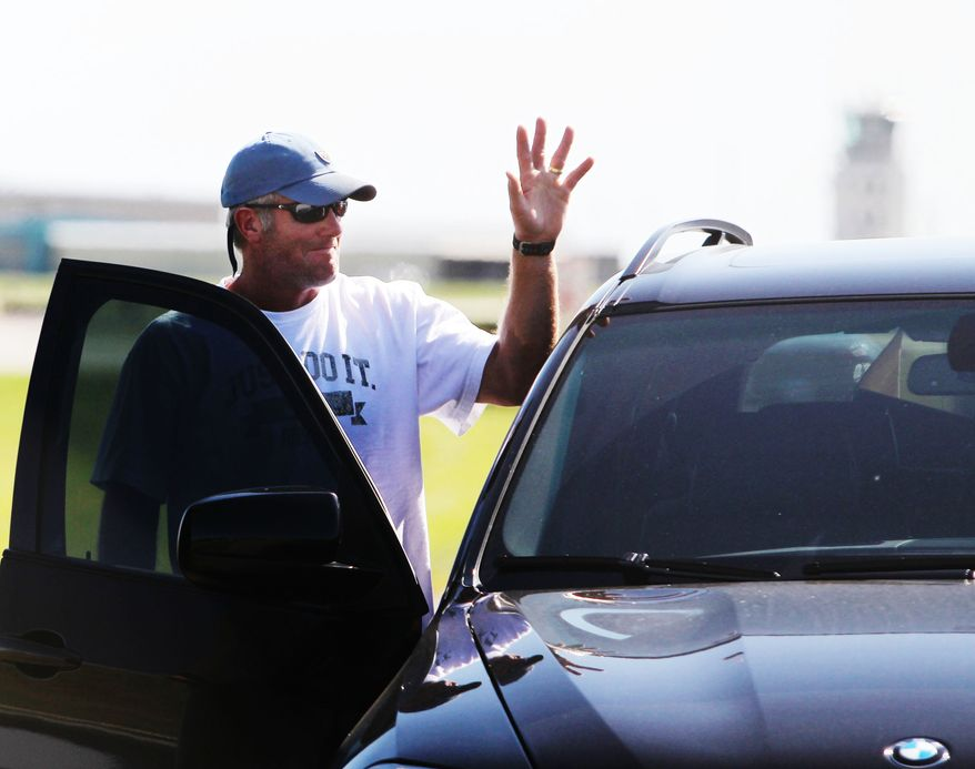 ASSOCIATED PRESS Minnesota Vikings quarterback Brett Favre waves to the media and football fans after arriving by a private jet at Flying Cloud Airport, Tuesday, Aug. 17, 2010 in Eden Prairie, Minn.