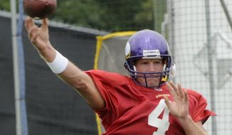 ASSOCIATED PRESS Minnnesota Vikings quarterback Brett Favre throws a pass during NFL football training camp, Wednesday, Aug. 18, 2010 in Eden Prairie, Minn. After staying away from training camp, Favre was practicing less than 24 hours after the team sent three of his closest friends to Mississippi to bring him back following another summer of indecision.